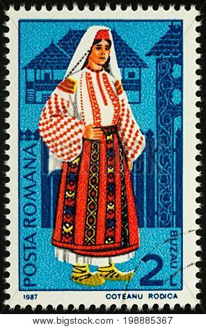 Moscow Russia - August 07 2017: A stamp printed in Romania shows young woman in Romanian national costume Buzau region series