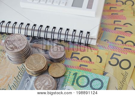 Australian money  AUD coins and banknotes with calculator notebook