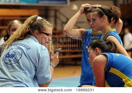KAPOSVAR, HUNGARY - OCTOBER 10: Marta Halasz (L) (Kaposvar trainer) explains at the Hungarian NB I. League woman volleyball game Kaposvar vs Veszprem, October 10, 2010 in Kaposvar, Hungary.