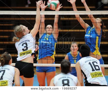KAPOSVAR, HUNGARY - OCTOBER 10: Dora Ihasz (14) blocks the ball at the Hungarian NB I. League woman volleyball game Kaposvar vs Veszprem, October 10, 2010 in Kaposvar, Hungary.