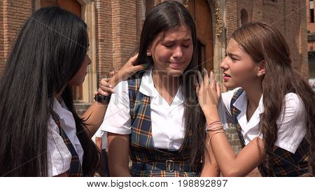 Depressed And Tearful Teen Girl Wearing School Uniforms