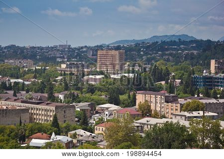 Day aerial cityscape of Sukhum downtown, view to Abkhazia Council of Ministers building