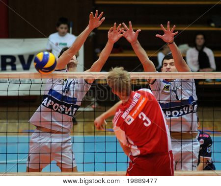 KAPOSVAR, HUNGARY - OCTOBER 15: Krisztian Csoma (L) blocks the ball at a Middle European League volleyball game Kaposvar (HUN) vs hotVolleys (AUT), October 15, 2010 in Kaposvar, Hungary