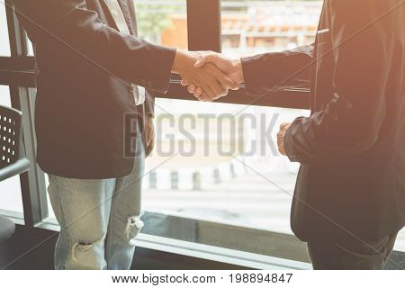 Business men shaking hands Agree on business