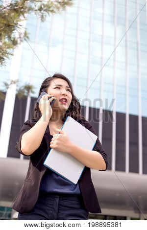 Asian Business Lady Front Of High Building