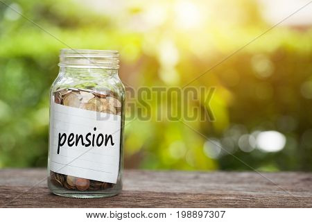pension Word With Coin In Glass Jar.
