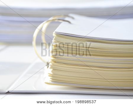 Stack of financial documents in document file on white table at workplace,business concept.