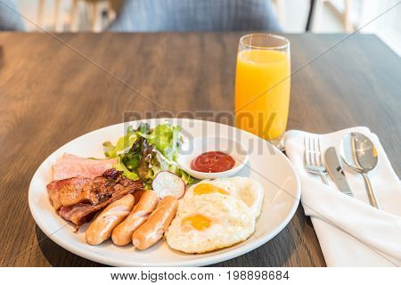 Breakfast Bacon and ham set with fried egg and orange juice