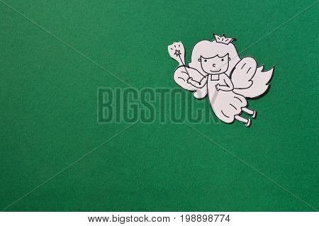 dental paper cut cute tooth fairy isolated on green background