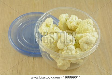 Food preparation of cauliflower florets in plastic storage container
