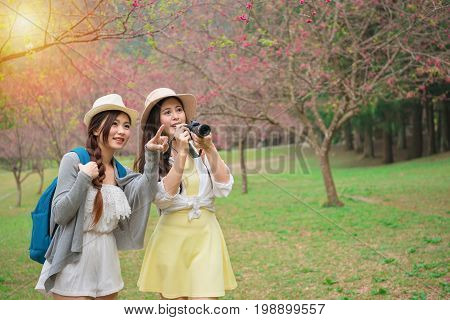 Beautiful Young Women Holding Travel Camera