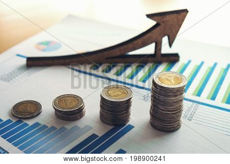 financial banking stock spreadsheet with stack coin and pen accountant data growth rate finance saving investment business and banking concept.
