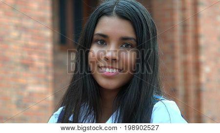 A Smiling Hispanic Teen Girl And Happiness