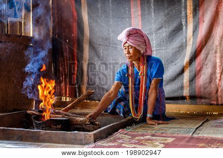Old female karen hill tribe is cooking traditional in the cottage of northern Thailand at Mae Klang Luang Mae Chaem Chiang Mai Province