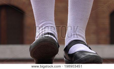 Girl Tapping Her Foot Wearing White Socks