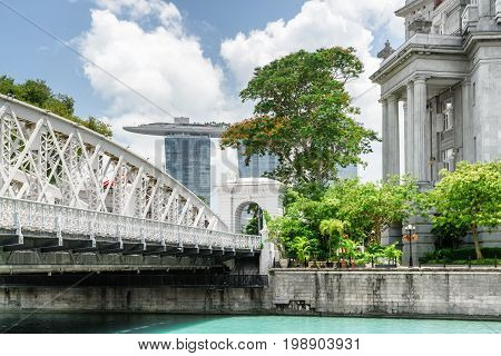 Old Colonial Building And White Bridge Over The Singapore River
