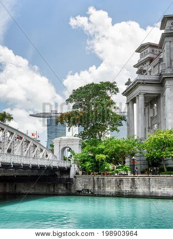 Old Colonial Building And Scenic Bridge Over The Singapore River
