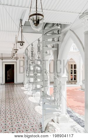 Scenic White Spiral Staircase At Gallery Of Colonial Building