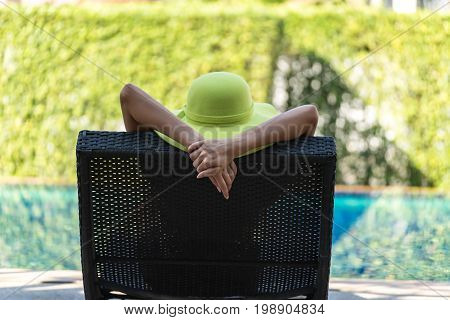 Real female beauty relaxing at swimming pool, summer vacation concept,Women in swimsuit relax with cocktails on the pool,happy,relax