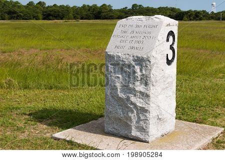 KILL DEVIL HILLS, NORTH CAROLINA - JULY 14, 2017:  Stone marker indicating the landing site of the third successful flight by Wilbur and Orville Wright at the Wright Brothers National Memorial.