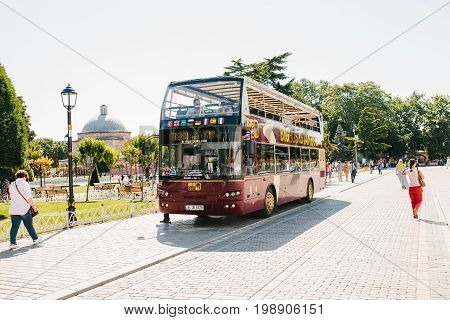 Editorial image of tourist sightseeing bus picking up passengers at the stop at Sultanahmet square in Istanbul on June 16, 2017.