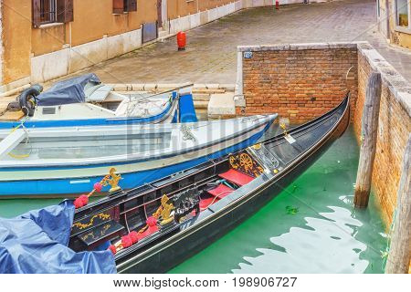 Views Of The Most Beautiful Channels Of Venice, Empty Gondola Near The Pier. Venice, Italy.