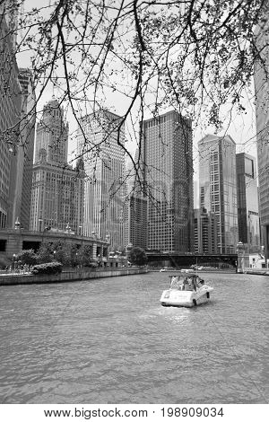 Boat Sailing Through A River In Downtown Of Chicago