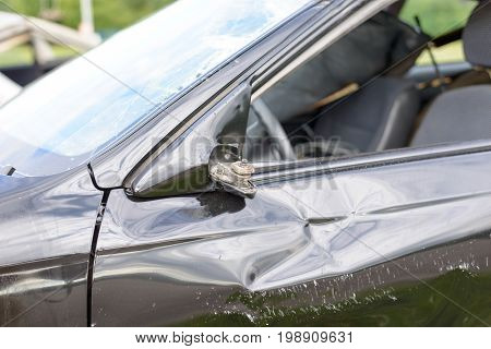 Damaged Car With Broken Sideview Mirror