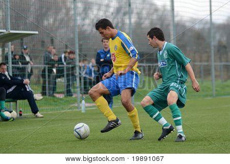 KAPOSVAR, HUNGARY - NOVEMBER 20: Daniel Pager (R) in action at the Hungarian National Championship under 19 game between Kaposvari Rakoczi and Puskas Academy November 20, 2010 in Kaposvar, Hungary.