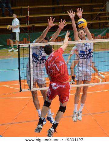 KAPOSVAR, HUNGARY - NOVEMBER 25: Krisztian Csoma (R) blocks the ball at the CEV Cup volleyball game Kaposvar (HUN) vs Resovia Rzeszov (POL), November 25, 2010 in Kaposvar, Hungary