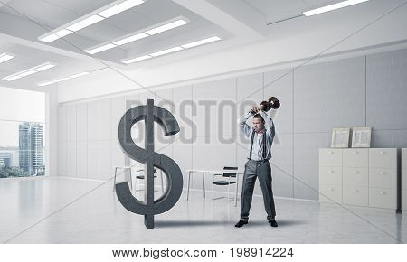 Young furious businessman going to crash with violin stone dollar symbol