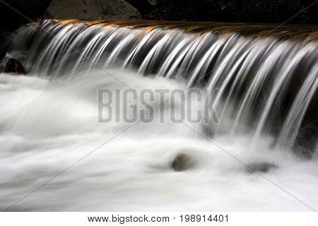 Nice cascade of small waterfall on mountain brook