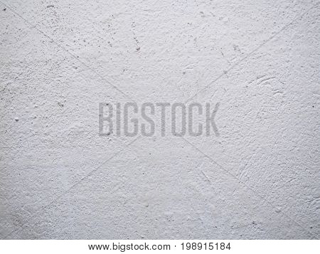 Texture of the putty. White plastered wall with stains and drips on a surface close-up. Macro photography colored texture of background.