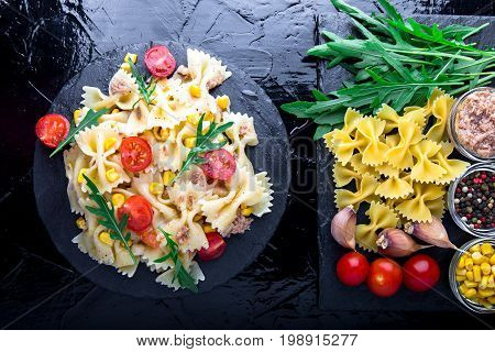 Pasta Salad In Slate Plate With Tomatoes Cherry, Tuna, Corn And Arugula. Top View. Ingredients. Ital