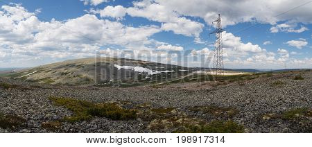 Panorama of mountains with high-voltage power lines in South Yakutia Russia