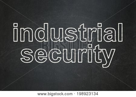Protection concept: text Industrial Security on Black chalkboard background