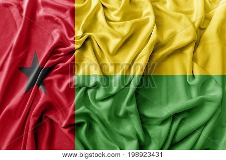 Ruffled waving Guinea flag national flag close