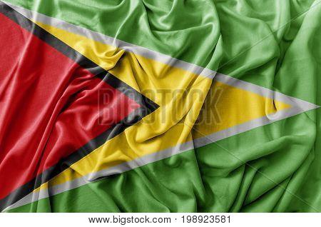 Ruffled waving Guyana flag national flag close