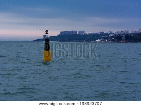 Sea buoy at the entrance to the seaport of Odessa in the evening of July 12 2017