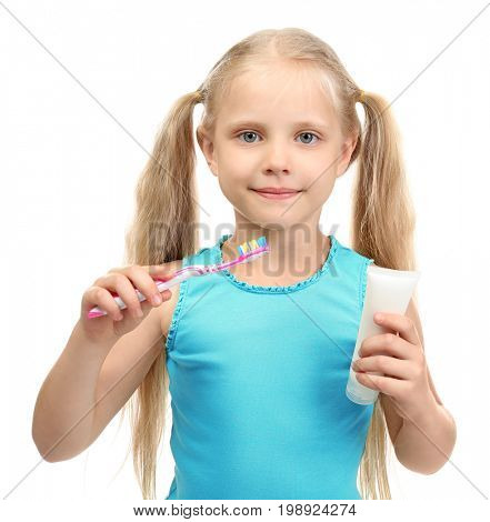 Cute girl with toothbrush and paste on white background. Teeth cleaning concept