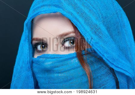 Closeup Of Gorgeous Young Woman Wearing Blue Veil