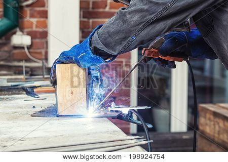 Welder Is Welding A Mettalic Construction