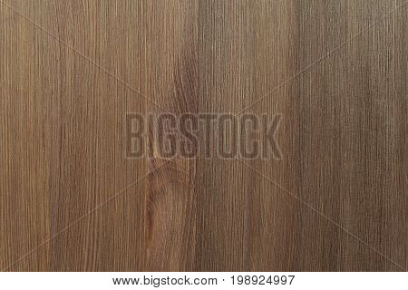 Natural color wooden floor surface. Textured background from woodnut planks. Vertical grain.