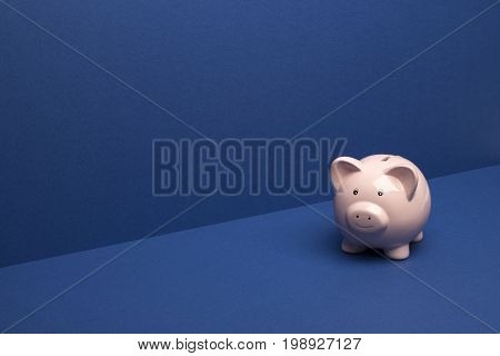 Piggybank On Blue Wall/floor Background With Copy Space