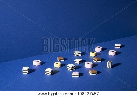Various Biscuits And Shortbread Squares On Blue Background Copy Space