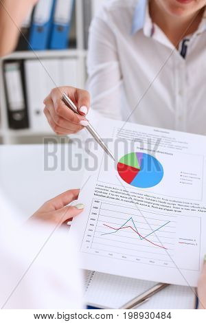 Businesswoman Holding A Silver Pen In Her Hand