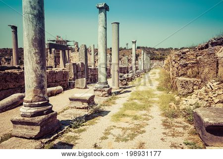 Ancient ruins of Perge. Agora. Stylized color film. Toning. Turkey.