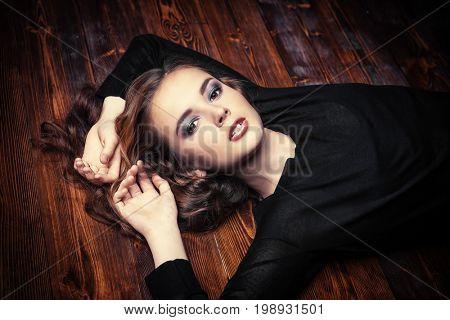 Beautiful girl with long curly hair. Beauty, fashion. Healthy hair, haircare cosmetics.