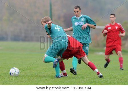 KAPOSVAR, HUNGARY - OCTOBER 16: Krisztian Mikola (L) in action at the Hungarian National Championship under 19 game between Kaposvar and Debrecen October 16, 2010 in Kaposvar, Hungary.