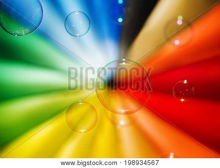 Soap bubbles and multi-coloured background. Celebratory concept.